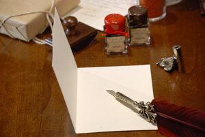 Papel de carta, billetes y marcadores