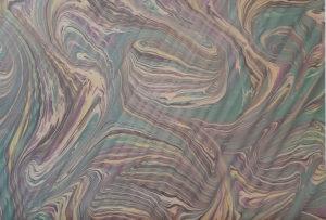 Reproduktion eines marmorierten und handgekämmten Papiers.