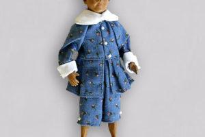 Pinocchio bambino, marionetta composta da cinque pezzi snodati in terracotta decorati a mano