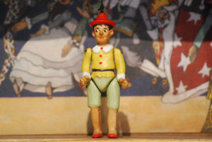 Pinocchio, a small terracotta puppet made up of five hand-decorated jointed pieces