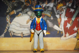 Grillo Parlante, a small terracotta puppet made up of five hand-decorated jointed pieces