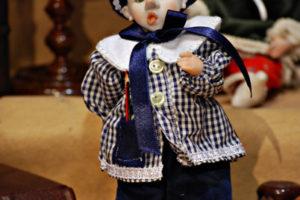 Pinocchio scolaro blù con occhi di vetro
