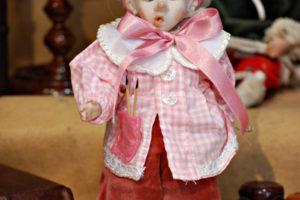 Pinocchio scolaro somaro rosa con occhi di vetro