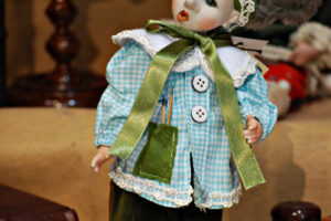 Pinocchio scolaro somaro verde con occhi di vetro