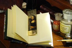 Segnalibro raffigurante 'La Gioconda' o 'Monna Lisa' con cornice in oro a caldo